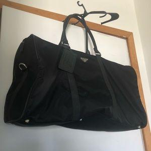 21fa4df7b701 Prada Small Leather Trimmed Duffel Bag